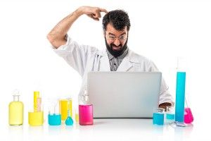 Scientist with his laptop thinking